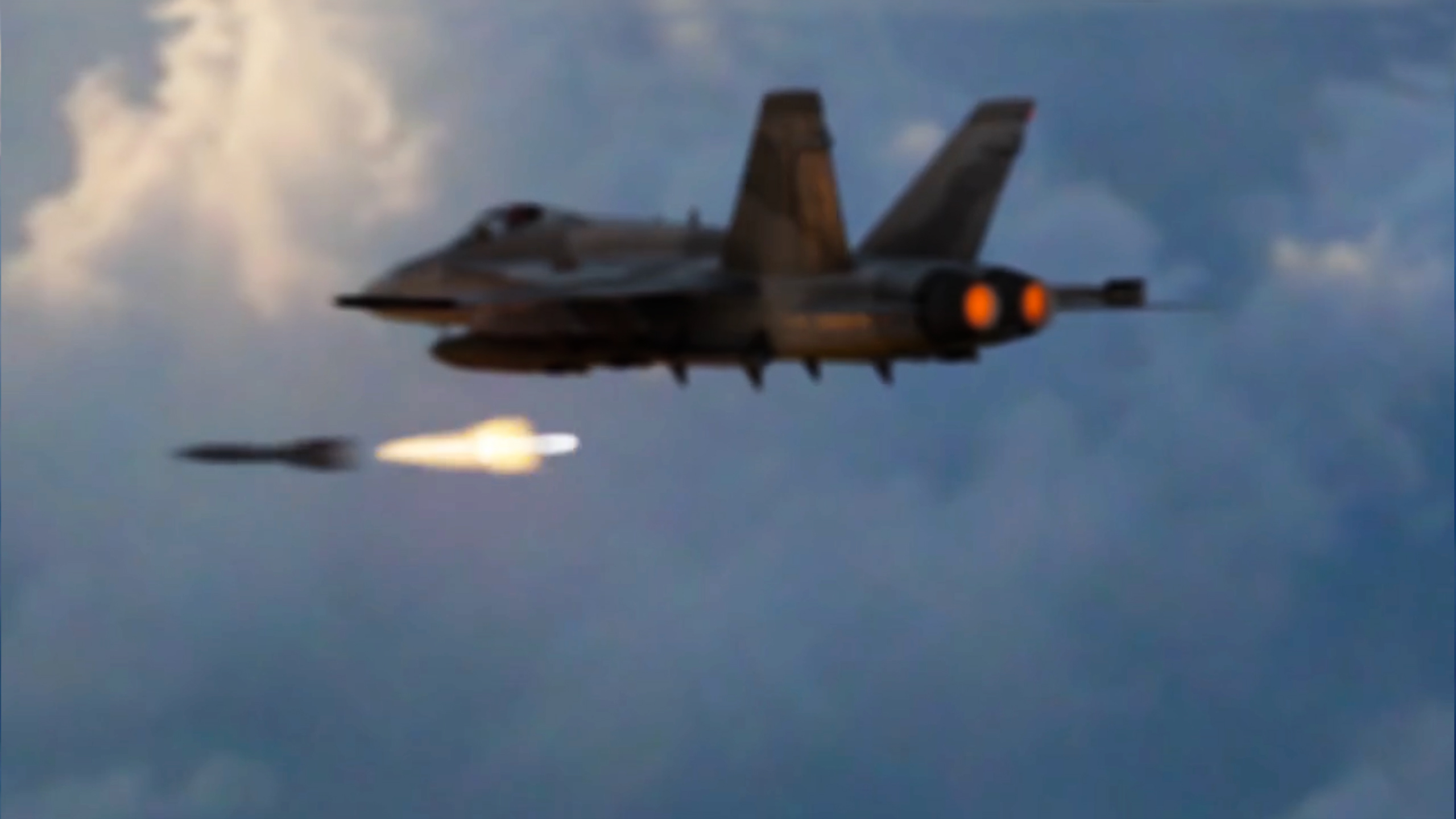 3D jet fighter launching missle in cloudy sky
