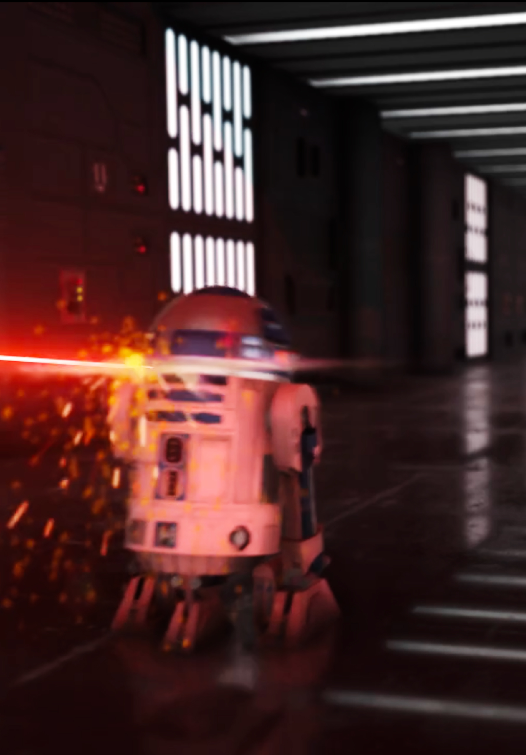 Close up of R2D2 being struck by red laser beam