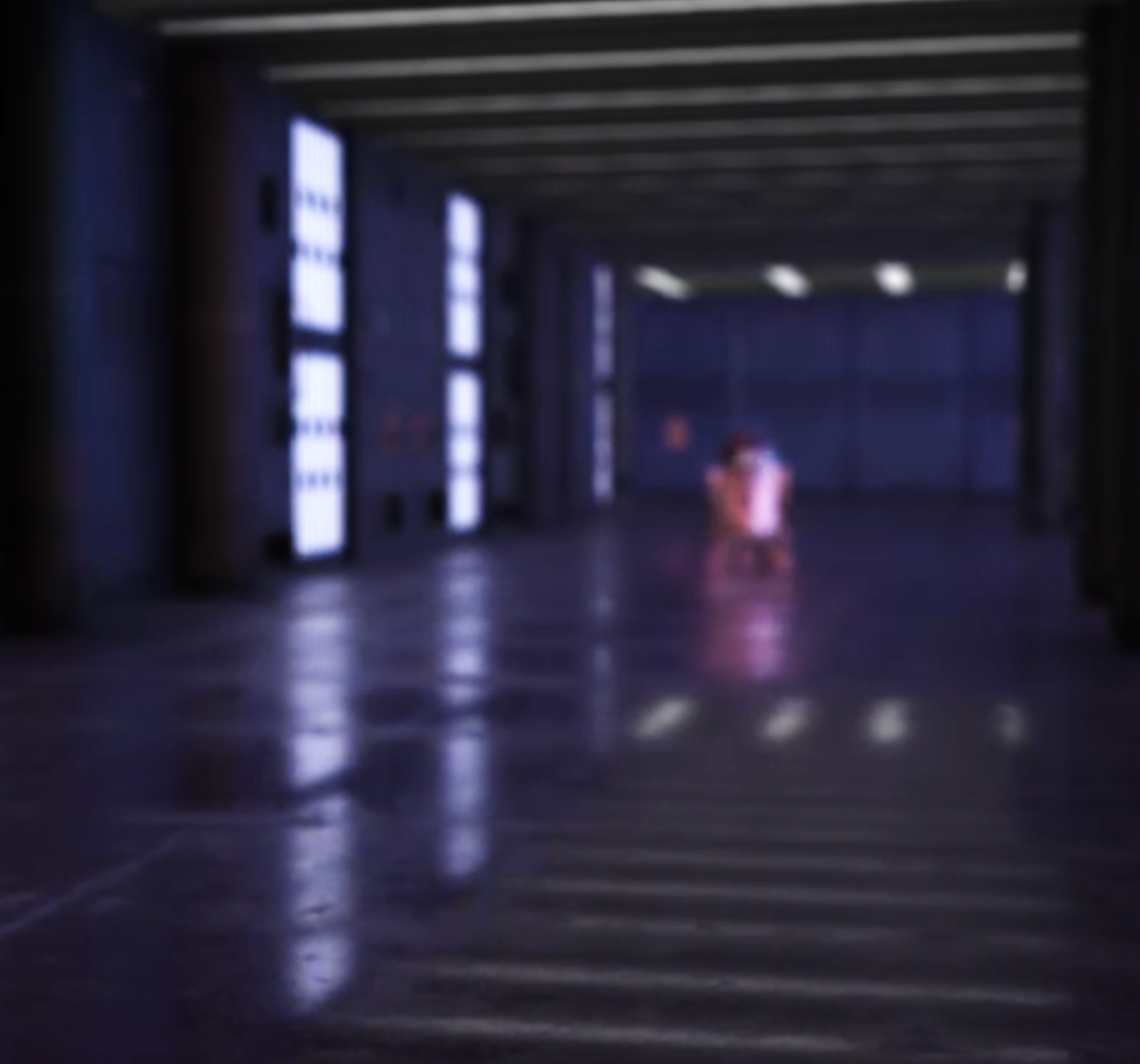 R2D2 blurry in the distance of long space corridor