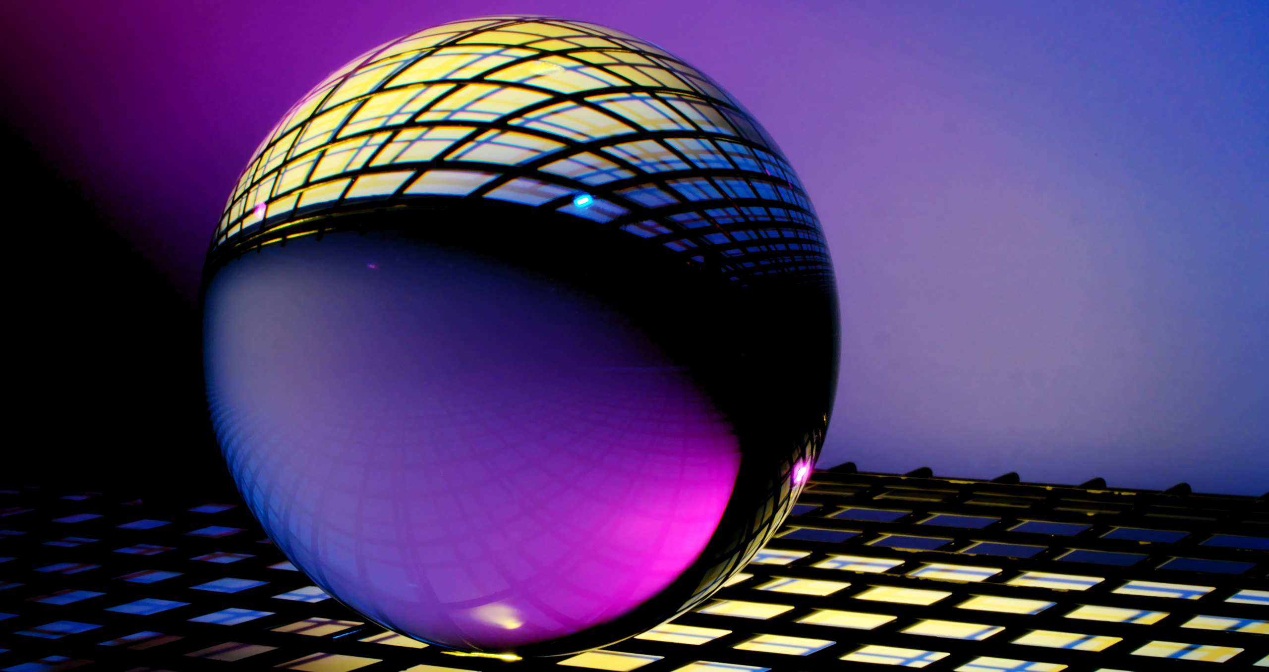 Transparent sphere inverting background of cubes with purple-blueish background colors